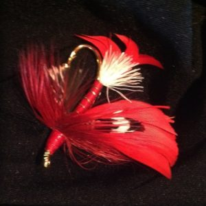 Red, White and Black fly fishing feather lapel pin.