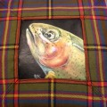 Hand painted rising rainbow trout sewn into a tartan pillow.