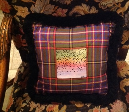 Hand painted rainbow trout skin sewn into a tartan pillow.