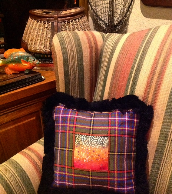 Brook trout spots painted on lambskin and framed in tartan & fringe